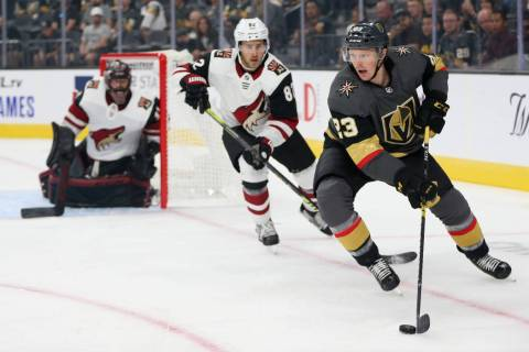 Vegas Golden Knights center Patrick Brown (23) looks for an open play against Arizona Coyotes d ...