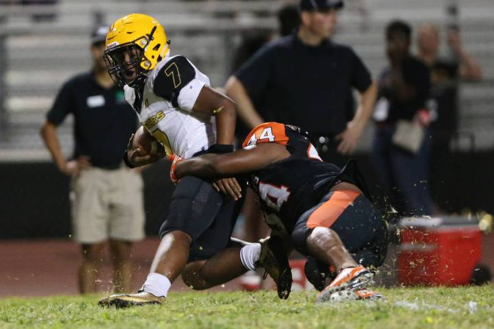 Clark's My'quel Johnson (7) is tackled by Chaparral's Robert Whitstone (44) in the second quart ...