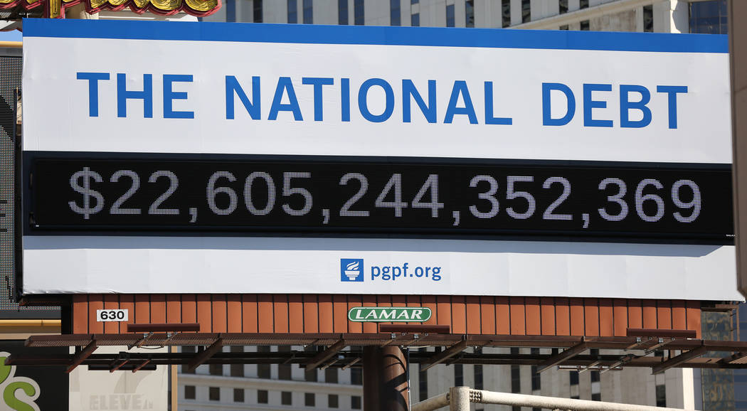 A billboard depicting rising national debt is seen on Las Vegas Boulevard directly across from ...