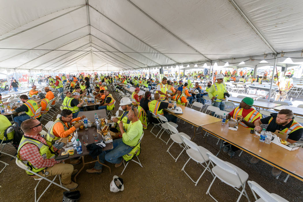 Construction workers enjoy a lunch prepared by Levy, the team's newly announced food service pa ...