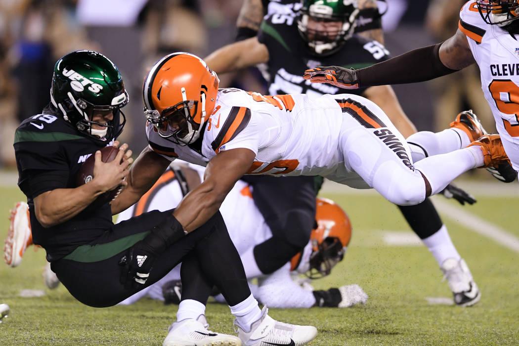 FILE - In this Sept. 16, 2019, file photo, Cleveland Browns' Myles Garrett (95) sacks New York ...