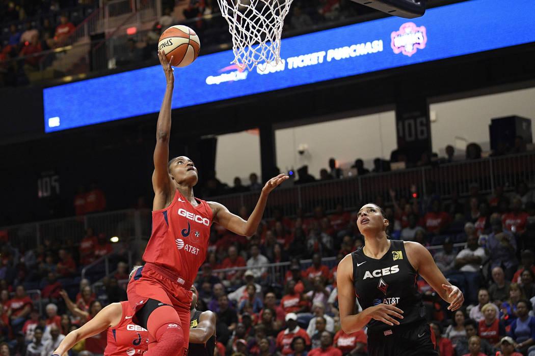 Washington Mystics forward LaToya Sanders, left, goes to the basket against Las Vegas Aces cent ...