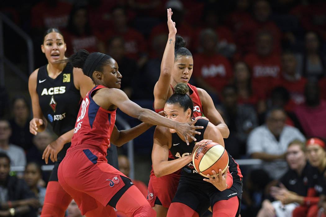 Las Vegas Aces guard Kayla McBride, right, tries to get past Washington Mystics forward LaToya ...