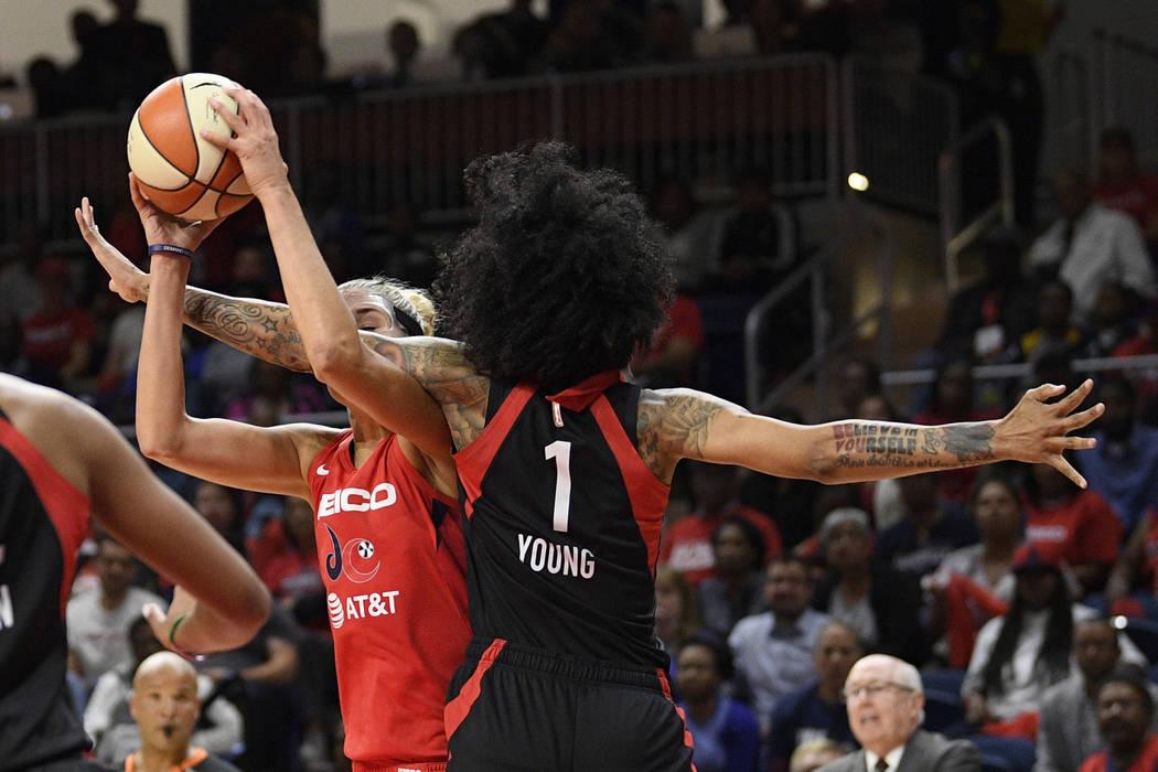 Washington Mystics forward Elena Delle Donne, left, is fouled by Las Vegas Aces forward Tamera ...