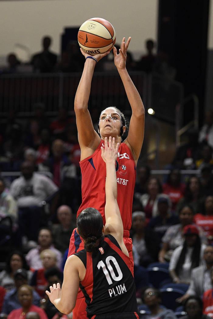 Washington Mystics forward Elena Delle Donne shoots over Las Vegas Aces guard Kelsey Plum (10) ...