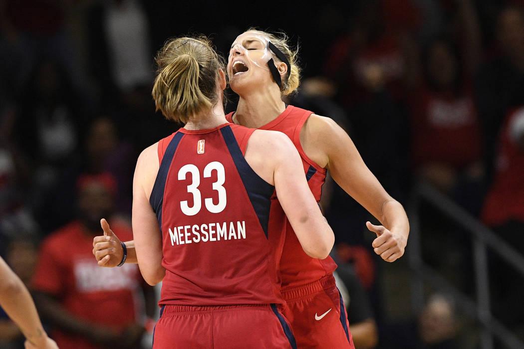 Washington Mystics center Emma Meesseman (33) and Elena Delle Donne, back reacts during the sec ...