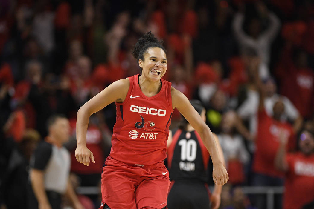 Washington Mystics guard Kristi Toliver reacts after making a basket during the second half of ...
