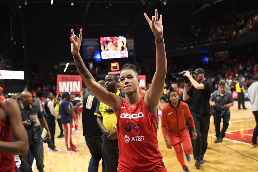 Washington Mystics guard Natasha Cloud gestures as she walks off the court after Game 2 of the ...