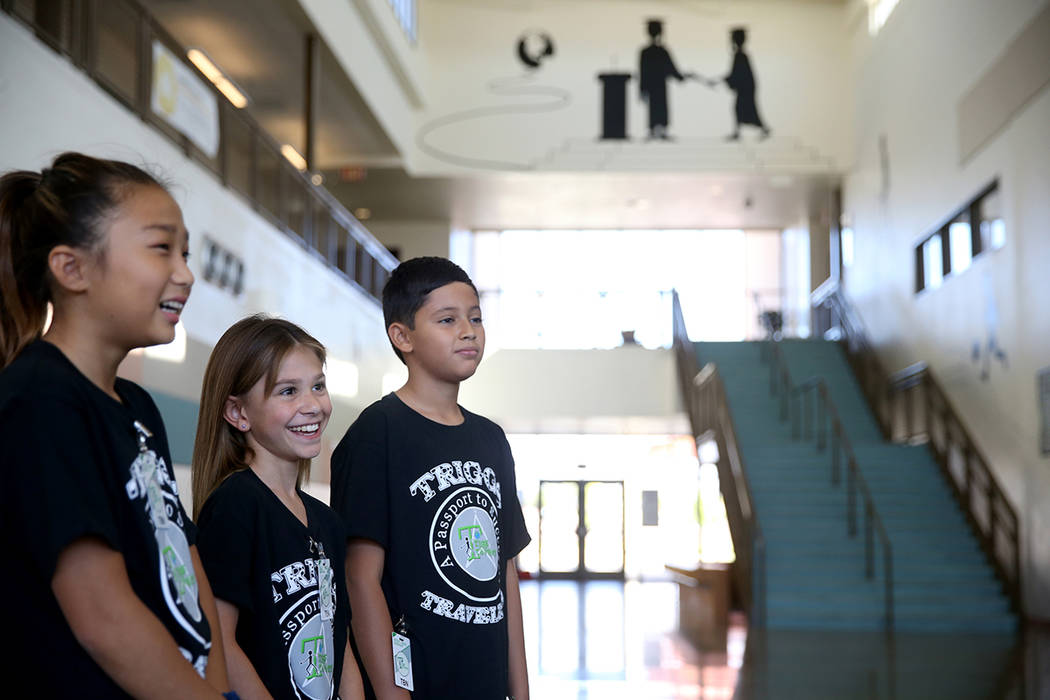 Triggs Elementary students, from left, fifth grader Anna Jung, 10, fourth grader Kaylee Wood, 8 ...