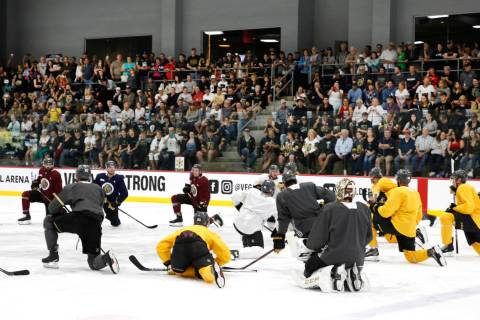 Fans watch as Golden Knights players stretch during team practice at City Center Arena on Wedne ...