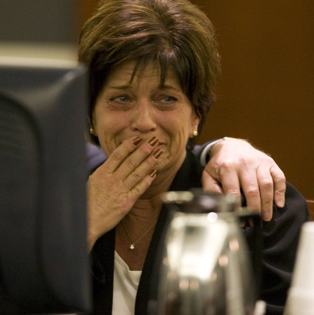 Sheri Weiss cries while a verdict in read in Clark County District Court on Feb. 27, 2009. The ...