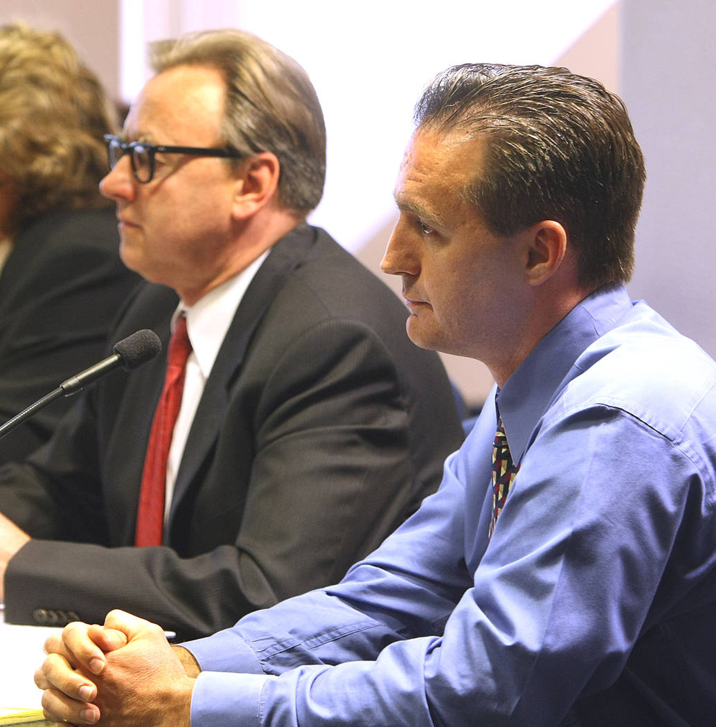 Chiropractor Stephen Shaw, right, appears before the Nevada Chiropractic Physician's Board with ...