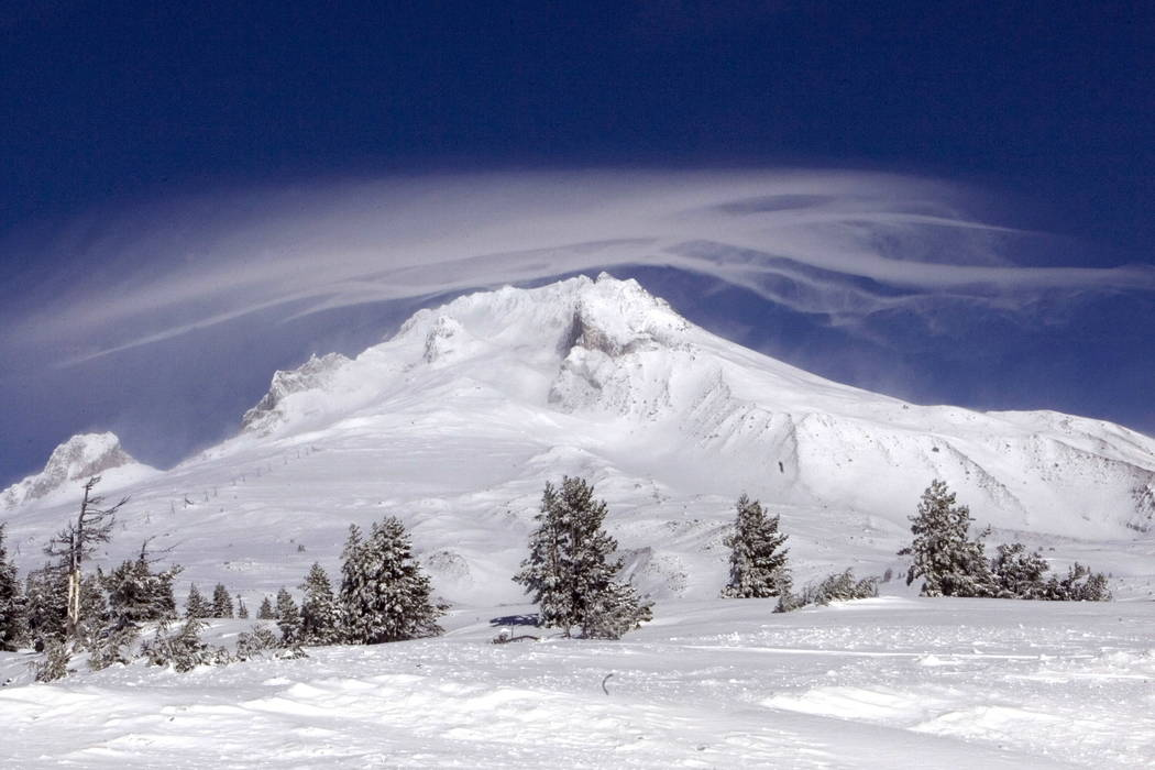 A cloud forms over Mount Hood as seen from Government Camp, Ore. (AP Photo/Don Ryan, File)