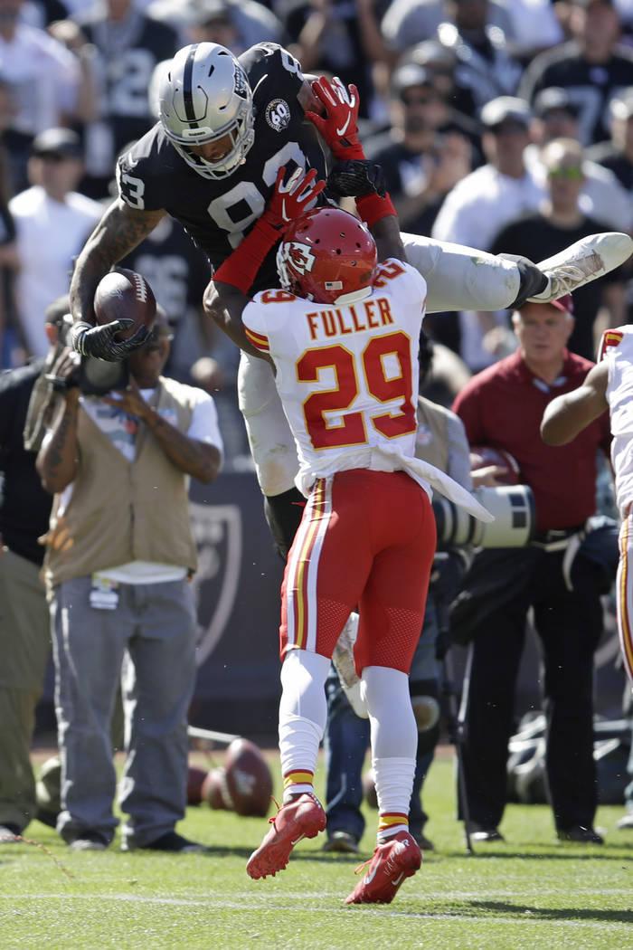 Oakland Raiders tight end Darren Waller carries the ball over Kansas City Chiefs cornerback Ken ...