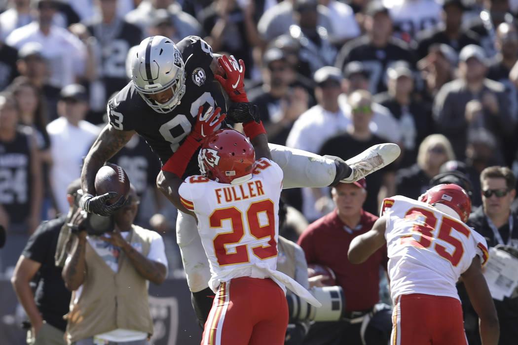 Oakland Raiders tight end Darren Waller, leaps over Kansas City Chiefs cornerback Kendall Fulle ...