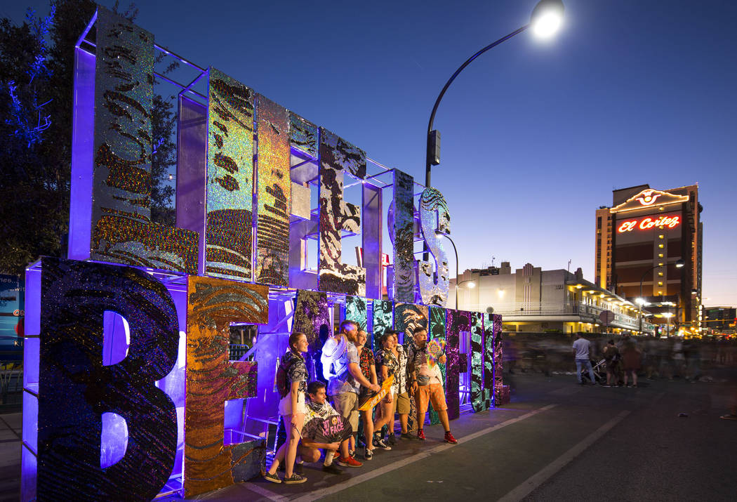 Festival-goers pose next to a Life is Beautiful sign on day three of the 2018 festival in downt ...