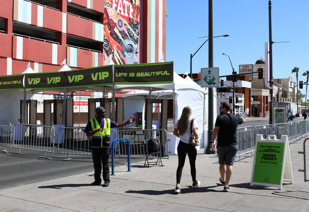 A security guard stops pedestrians as Fremont Street is closed for pedestrian and motor vehicle ...