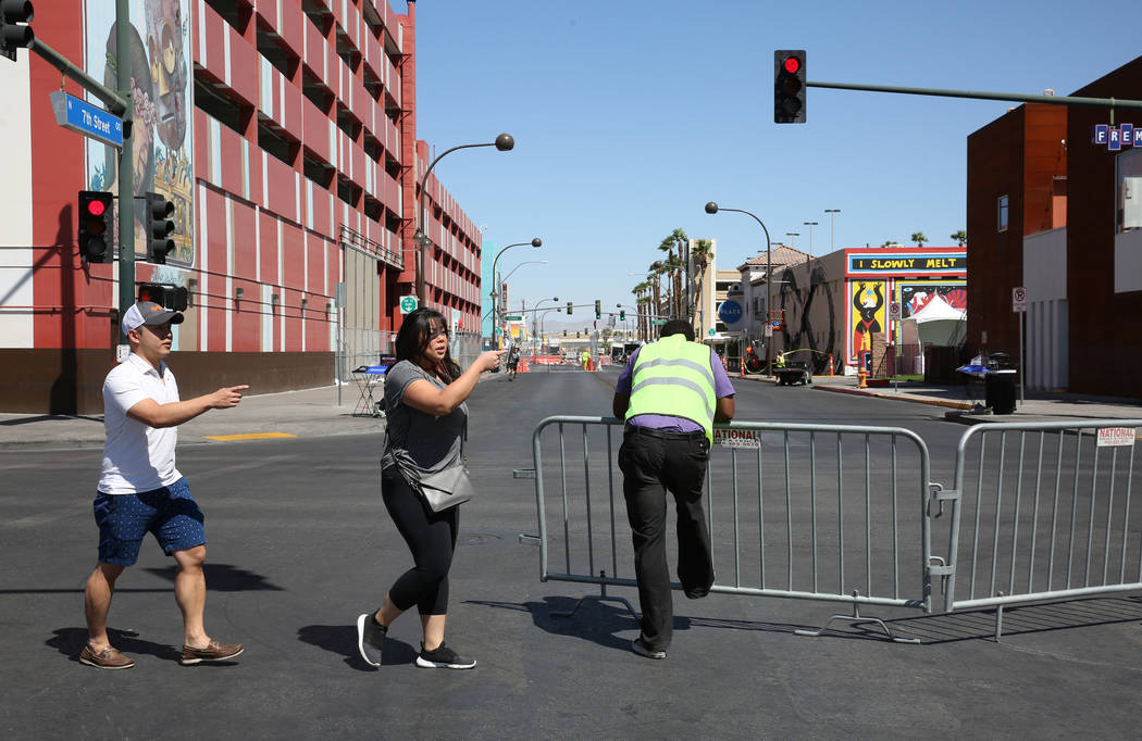Pedestrians take alternate side street after finding out that Fremont Street is closed for pede ...