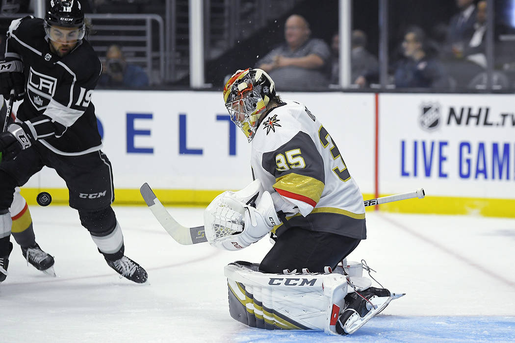 Vegas Golden Knights goaltender Oscar Dansk, right deflects a shot as Los Angeles Kings left wi ...