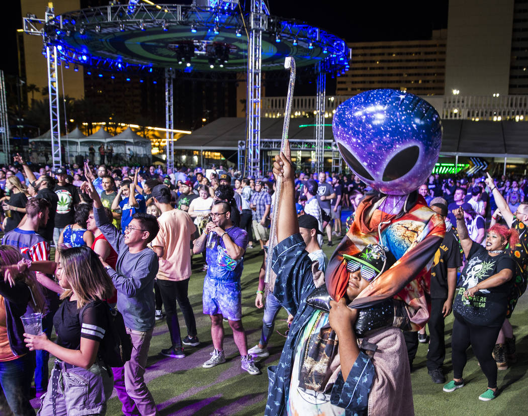 Attendees dance to TYPE3 during the Area 51 Celebration on Thursday, Sept. 19, 2019, at Downtow ...