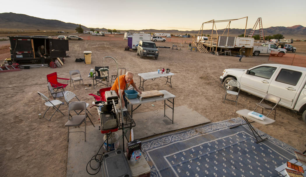 George Morrow readies the site about his camper for serving breakfast to the stage construction ...