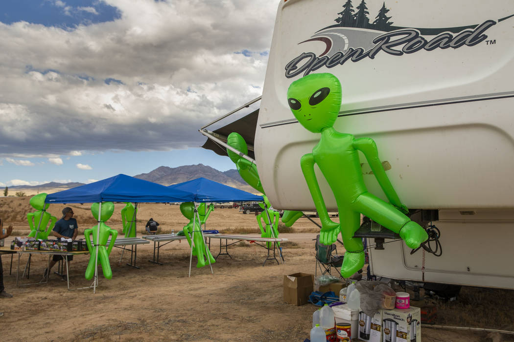 Aliens hang on a merchandise and supply tent as the start of the Alienstock festival nears on T ...