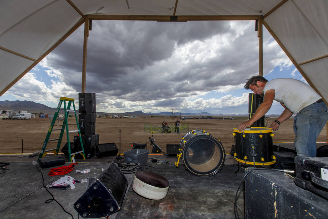 Jeremy Morrow of Wily Savage from Hollywood begins to set up his drums on the new main stage wi ...