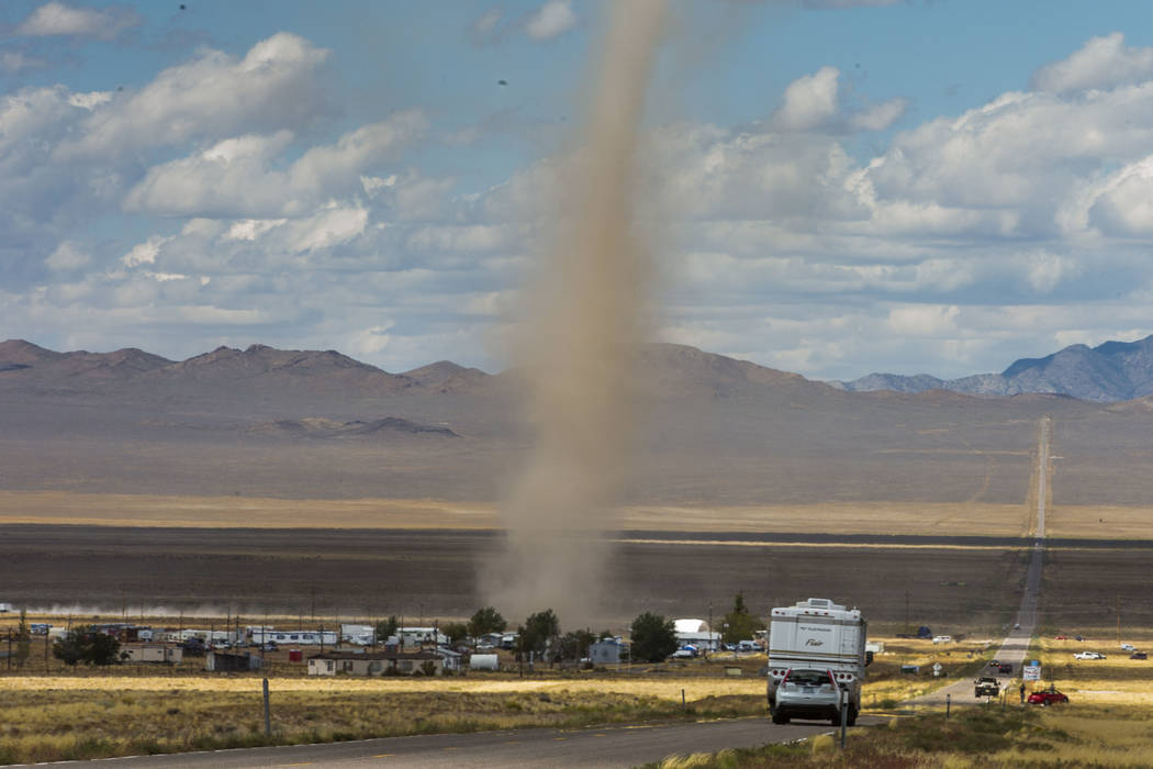 Large dust devil kicks up debris as it passes through Rachel off of state Route 375 as preparat ...