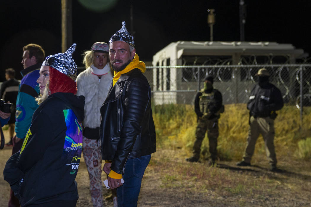 Individuals gather in homage to the original Storm Area 51 idea about 3 a.m. at the back gate o ...