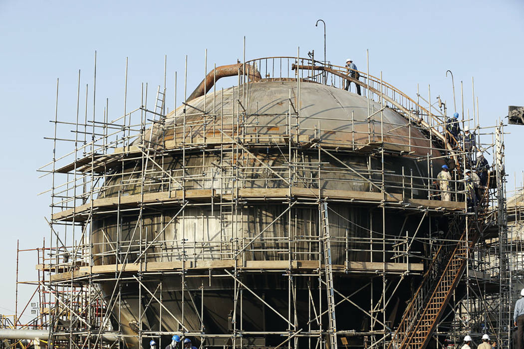 During a trip organized by Saudi information ministry, workers fix the damage in Aramco's oil s ...