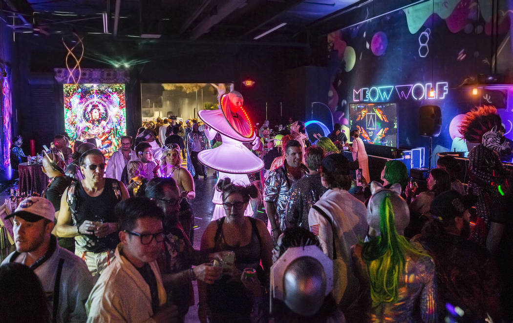 Alien-themed party goers socialize during a pre-party for Storm Area 51 on Thursday, Sept. 19, ...