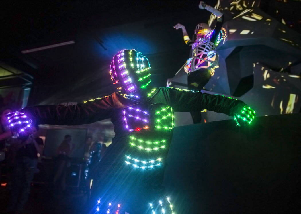 Alien-themed dancers entertain the crowd during a pre-party for Storm Area 51 on Thursday, Sept ...