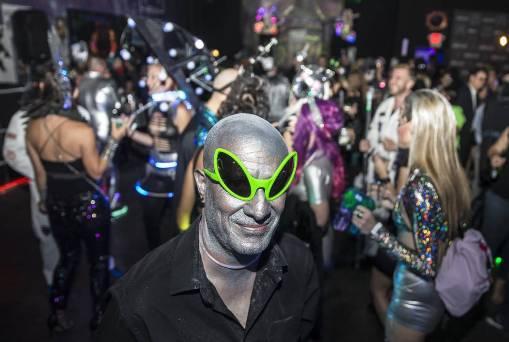Seth Stylz dresses as a silver and green alien during a pre-party for Storm Area 51 on Thursday ...
