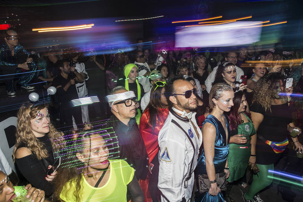 Attendees watch the Big Nazo Intergalactic Creature Band perform during a pre party for Storm A ...