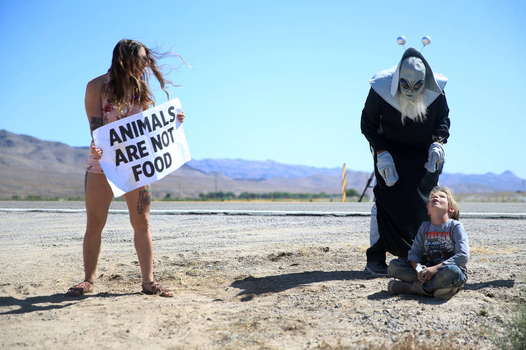 Animal rights activist Frankie Schoen of Philadelphia, from left, looks on as Jess Barrios of L ...