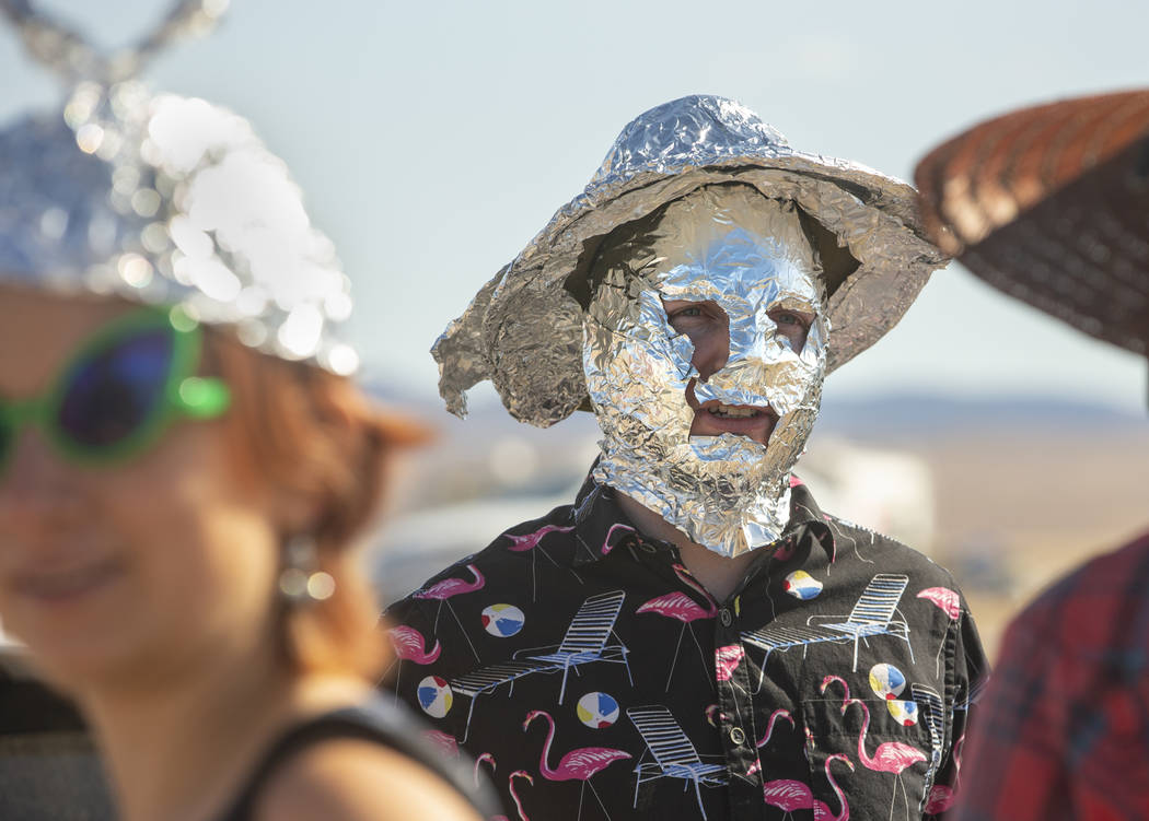 Chris Reid of Reno makes tinfoil hats for festivalgoers during the Alienstock festival on Frida ...