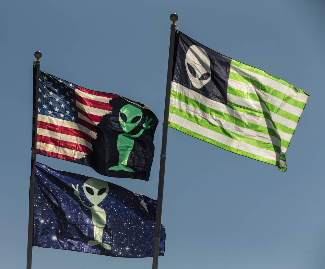 Alien flags fly from an RV during the Alienstock festival on Friday, Sept. 20, 2019 in Rachel, ...