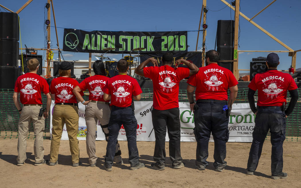 Medical personnel gather in front of the main stage during the Alienstock festival on Friday, S ...