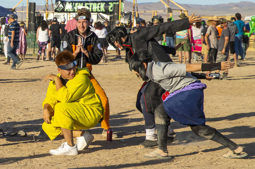 Festivalgoers strike the Naruto run pose and others during the Alienstock festival on Friday, S ...