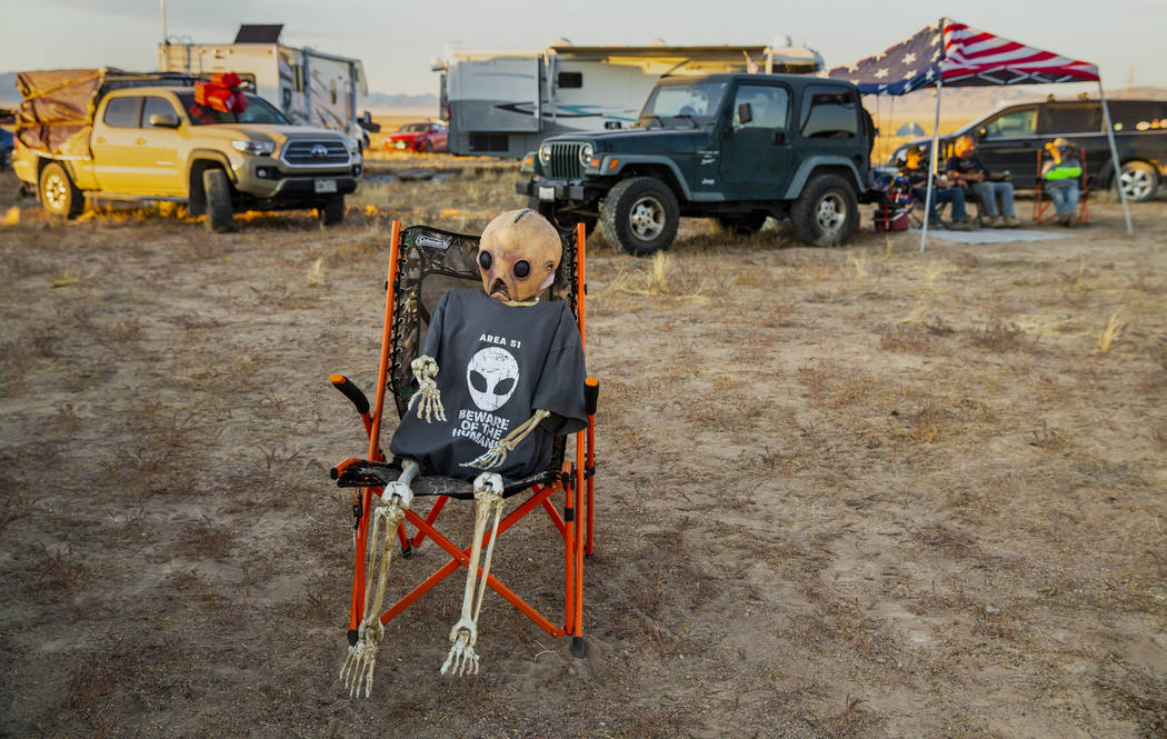 An alien relaxes in the off-site parking across from the Alienstock festival on Friday, Sept. 2 ...