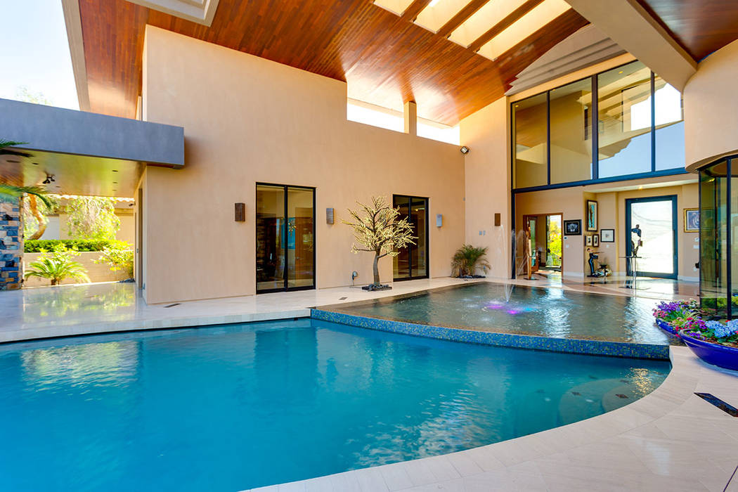 Ivan Sher Group Rick Sender designed the pool to nearly flow into the home.