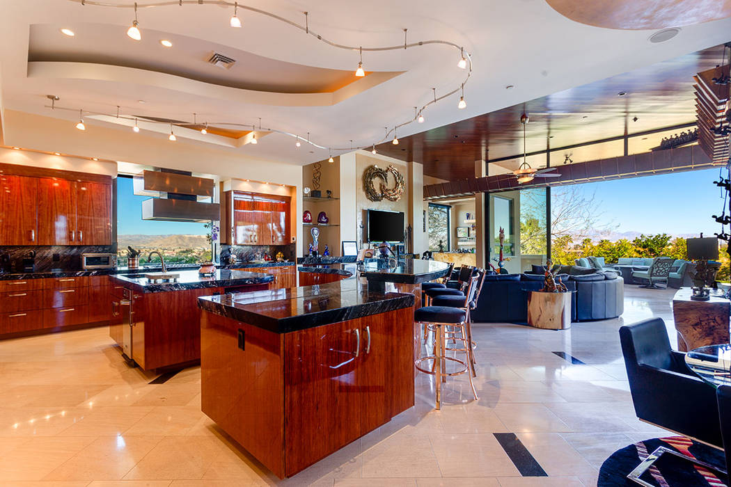 Ivan Sher Group Ruth Sender designed her kitchen with high-gloss African bubinga wood used for ...