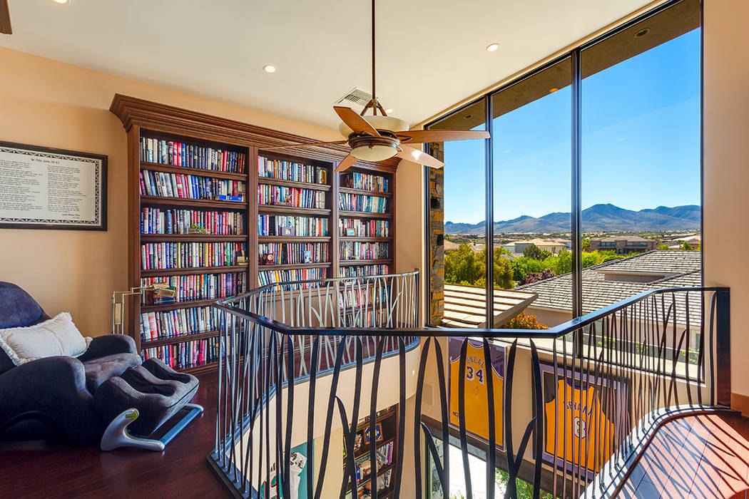 Ivan Sher The home features a two-story library with a reading loft.