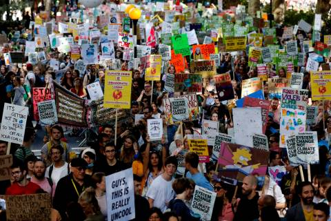 Climate protesters demonstrate in London, Friday, Sept. 20, 2019. Protesters around the world j ...