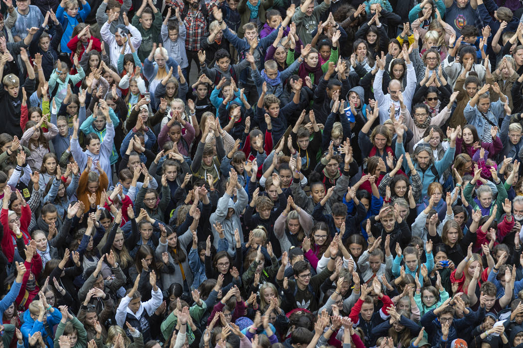 People attend a 'Fridays For Future' rally in Freiburg, Germany, Friday, Sept. 20, 2019. Protes ...