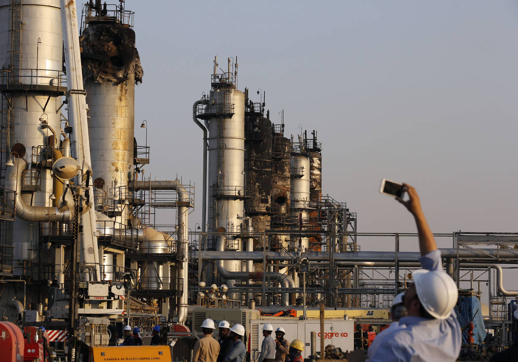 During a trip organized by Saudi information ministry, a cameraman films Aramco's oil processin ...