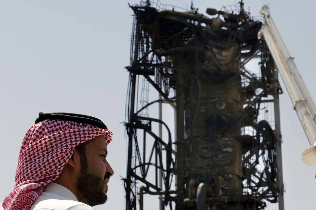 In this photo opportunity during a trip organized by Saudi information ministry, a man watches ...