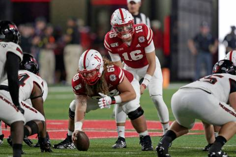 Nebraska quarterback Noah Vedral (16) stands behind offensive lineman Will Farniok (68) at the ...