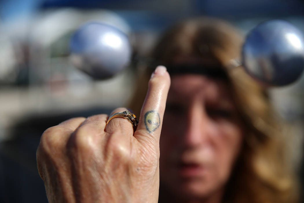 Trip Barrios of Las Vegas shows the alien tattoo on her finger while attending the Alien Baseca ...