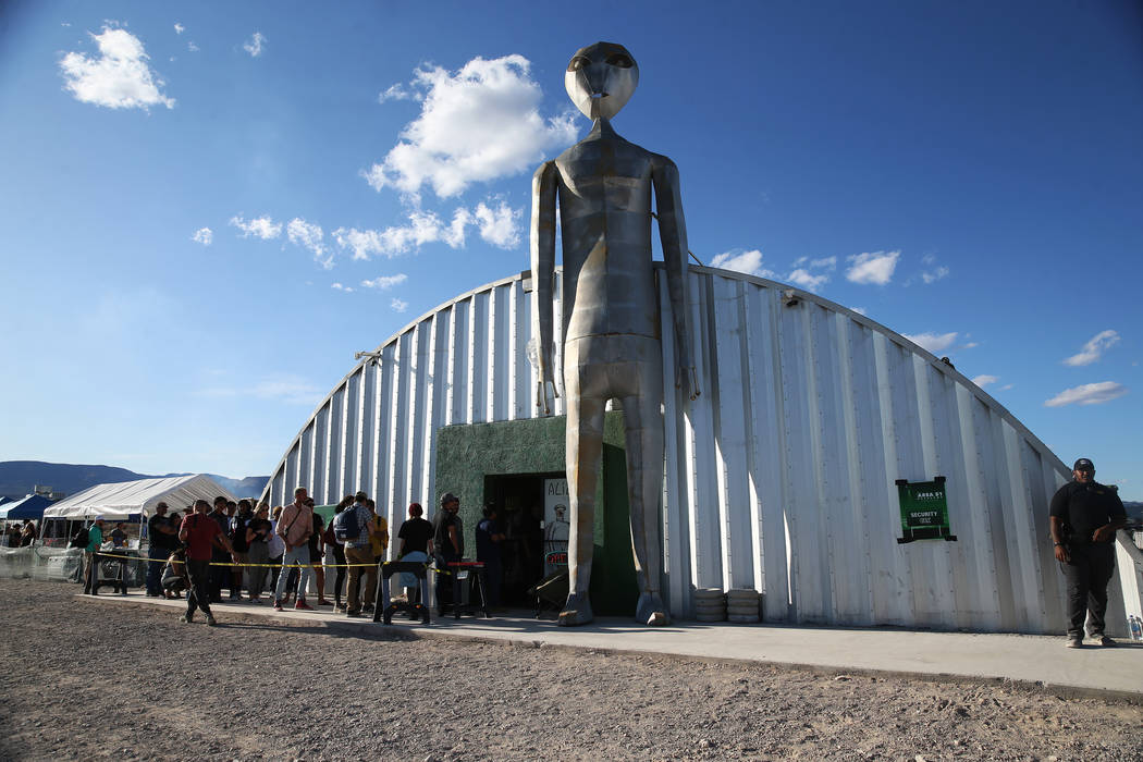People wait in line to enter the Alien Research Center store in Hiko, Nev., Friday, Sept. 20, 2 ...
